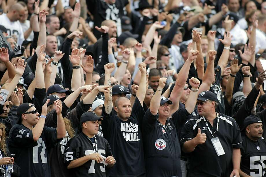 Fans celebrate the Oakland Raider's win over the New York Jets, 34-24,  in Oakland, Calif. on Sunday, Sept. 25, 2011. Ran on: 09-29-2011 Sunday's raucous, sold-out sea of Silver and Black was just like the old Oakland dynasty days. Photo: Thomas Webb, The Chronicle