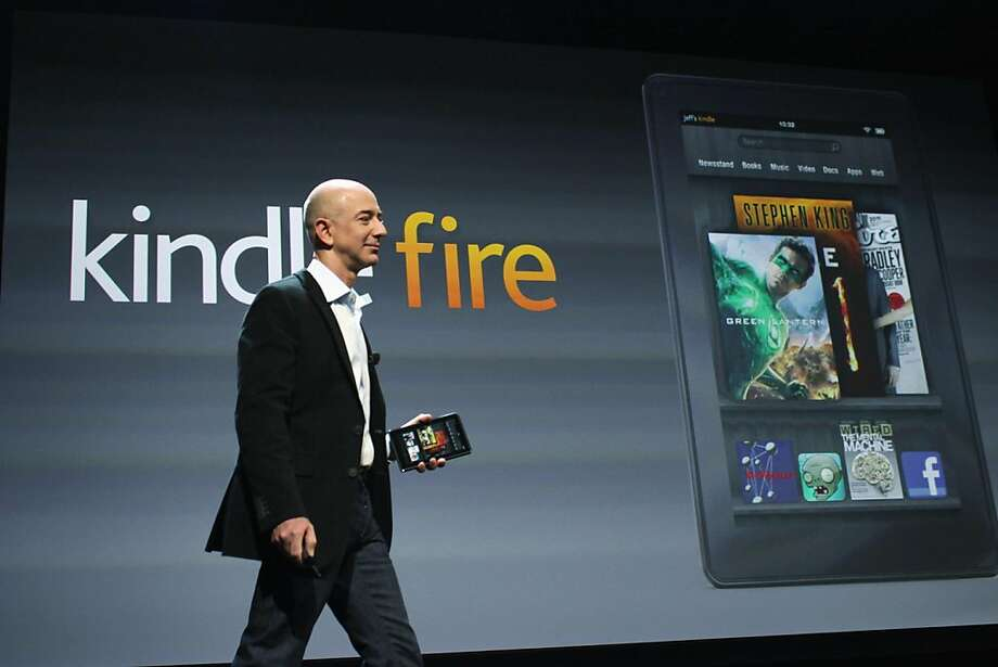 NEW YORK, NY - SEPTEMBER 28:  Amazon founder Jeff Bezos holds the new Amazon tablet called the Kindle Fire on September 28, 2011 in New York City. The Fire, which will be priced at $199, is an expanded version of the companyâÛªs Kindle e-reader that has 8GB of storage and WiFi. The Fire gives users access to streaming video, as well as e-books, apps and music, and has a Web browser. In addition to the Fire, Bezos introduced four new Kindles including a Kindle touch model.  (Photo by Spencer Platt/Getty Images) Photo: Spencer Platt, Getty Images