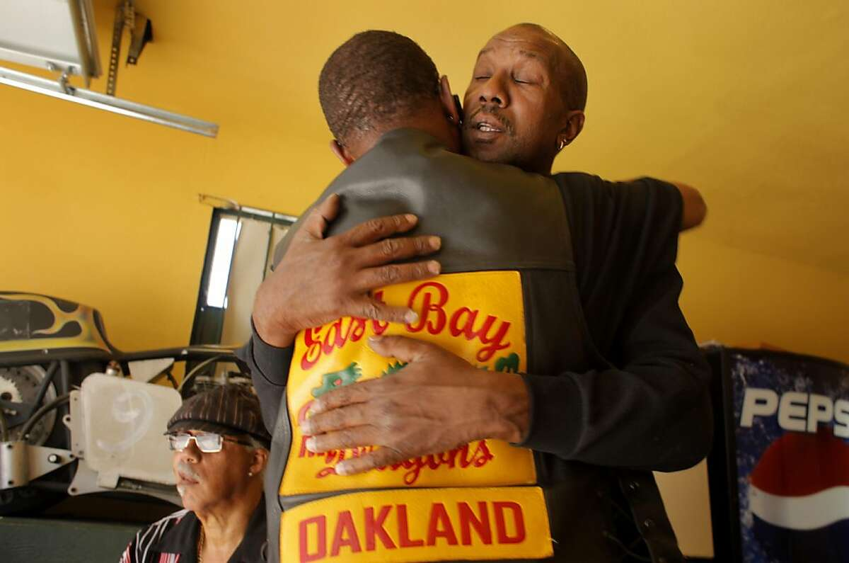 Members of the East Bay Dragons Motorcycle Club, Dre Crowe, right is consoled by member Jeff, as they mourn the loss of Hassan Sayyid also known as Ike, Monday September 28, 2010, in Oakland, Calif. Sayyid, 40-years -old was shot to death by a suspect that walked into the clubs garage Sunday night as the members were watching television.