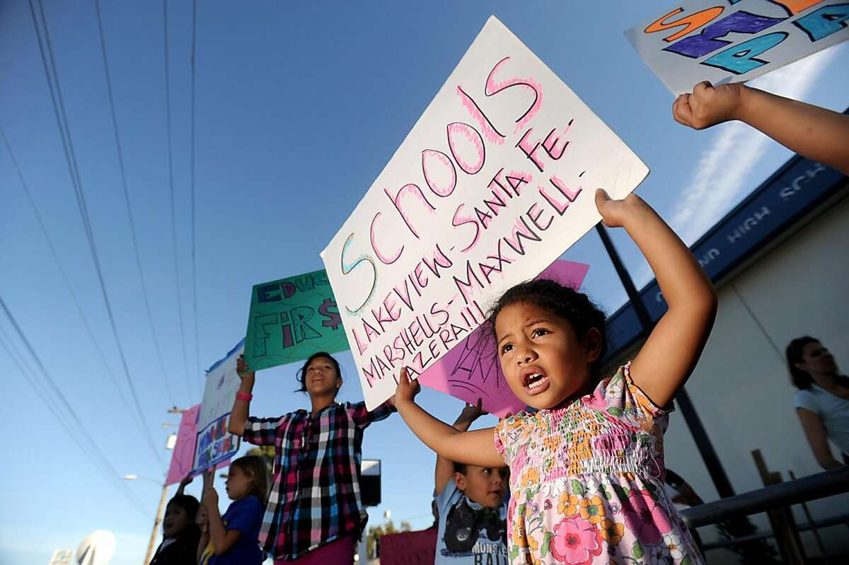 Henrietta Fonua, a kindergarten student at Maxwell Park Elementary School, protests outside an Oakland Board of Education meeting on Tuesday, Sept. 27, 2011, in Oakland, Calif.
