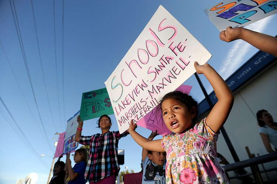 Henrietta Fonua, a kindergarten student at Maxwell Park Elementary School, protests outside an Oakland Board of Education meeting on Tuesday, Sept. 27, 2011, in Oakland, Calif. Photo: Noah Berger, Special To The Chronicle