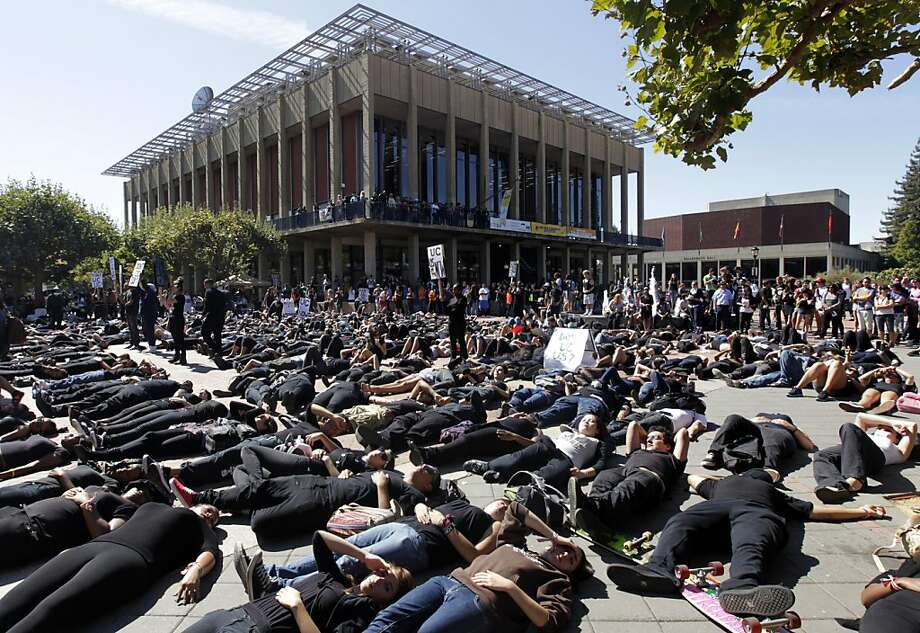 "Several hundred protesters stage a counter-demonstration by lying down on Sproul Plaza at Noon while the Berkeley College Republicans hold an ""Increase Diversity Bake Sale"" to satirize the controversial SB 185 at UC Berkeley on Tuesday, Sept. 27, 2011. The counter-demonstraters support the bill which, ff signed by Gov. Brown, would allow race and ethnicity to be considered for student admission. Photo: Paul Chinn, The Chronicle"