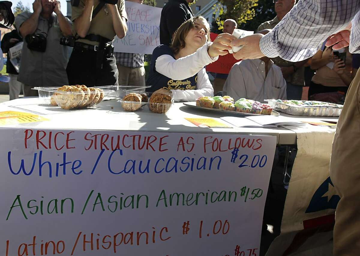 A student member of the Berkeley College Republicans, who is named Hannah, sells a cupcake at an