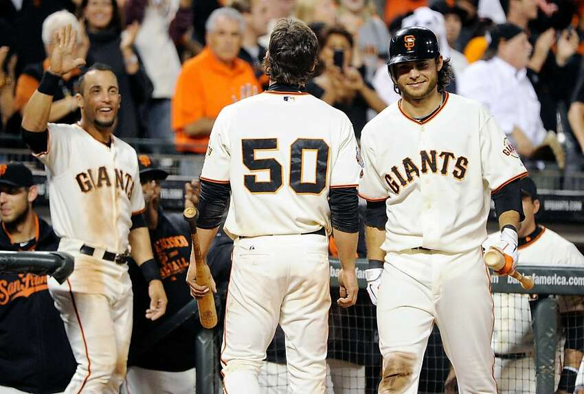 SAN FRANCISCO, CA - SEPTEMBER 27: Conor Gillaspie #50, Brandon Crawford #35 and Andres Torres #56 of the San Francisco Giants celebrate after Gillaspie hit an inside the park two-run home run against the Colorado Rockies in the seventh inning at AT&T Park on September 27, 2011 in San Francisco, California. (Photo by Thearon W. Henderson/Getty Images)