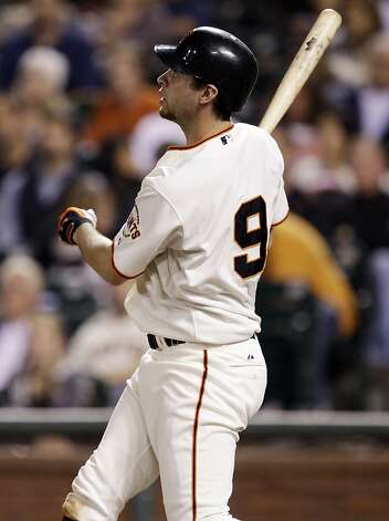San Francisco Giants' Brandon Belt hits a two-run home run against the Colorado Rockies during the fourth inning of a baseball game in San Francisco,  Tuesday, Sept. 27, 2011. (AP Photo/Marcio Jose Sanchez) Photo: Marcio Jose Sanchez, AP