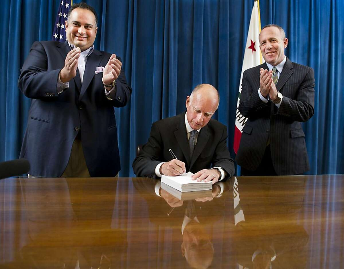 California Gov. Jerry Brown signs the state budget surrounded by Assembly Speaker John A. Perez, D-Los Angeles, left, and Senate President Pro Tem Darrell Steinberg, D-Sacramento, right, on Thursday, June 30, 2011 at the state Capitol in Sacramento, Calif.. (AP Photo/Hector Amezcua, pool) Ran on: 07-05-2011 Assembly Speaker John Pérez (left) and Senate President Pro Tem Darrell Steinberg applaud as Gov. Jerry Brown signs the state budget last week. Ran on: 08-10-2011 Amid applause and smiles, Gov. Jerry Brown signs the budget in June flanked by Assembly Speaker John Pérez (left) and state Senate President Pro Tem Darrell Steinberg. Ran on: 08-10-2011 Amid applause and smiles, Gov. Jerry Brown signs the budget in June flanked by Assembly Speaker John Pérez (left) and state Senate President Pro Tem Darrell Steinberg.