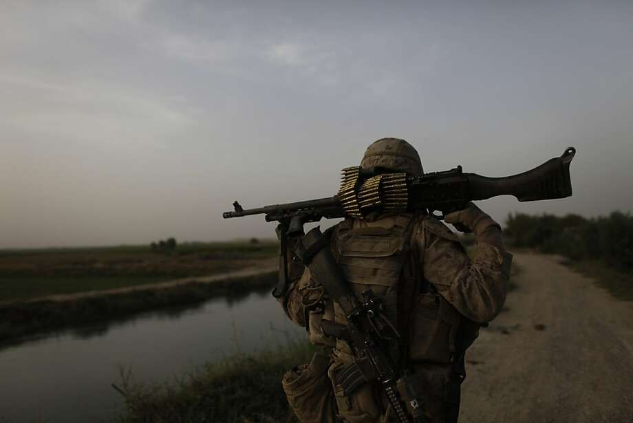Keep going for a look back at the machine guns the U.S. Military has used over the decades. In this Sept. 24, 2011 photo, nearing the end of his unit's tour of duty, a U.S. Marine carries a machine gun in Helmand province, southern Afghanistan. Photo: Brennan Linsley, AP