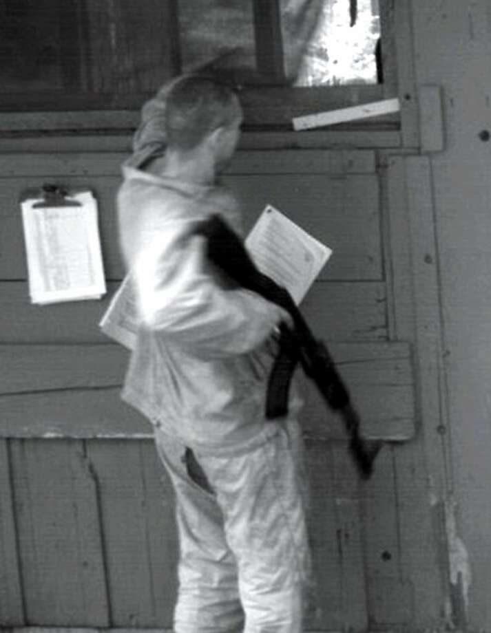 In this photo taken by a surveillance camera set up by law enforcement authorities, homicide suspect Aaron Bassler appears outside a vacation cabin in the woods near Fort Bragg. Authorities believe Bassler remains within a 400- square-mile area of forest between Fort Bragg and Willits. Photo: Mendocino County Sheriff