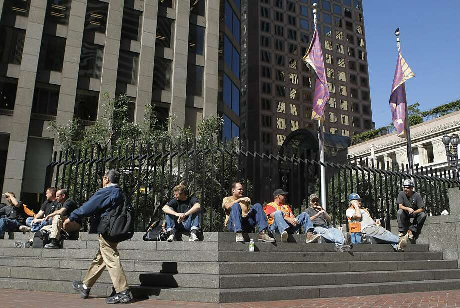 San Franciscans sitting at One Post Plaza, at the corner of Montgomery and Market in San Francisco, Calif., on Monday, Sept. 26, 2011. Photo: Dylan Entelis, The Chronicle