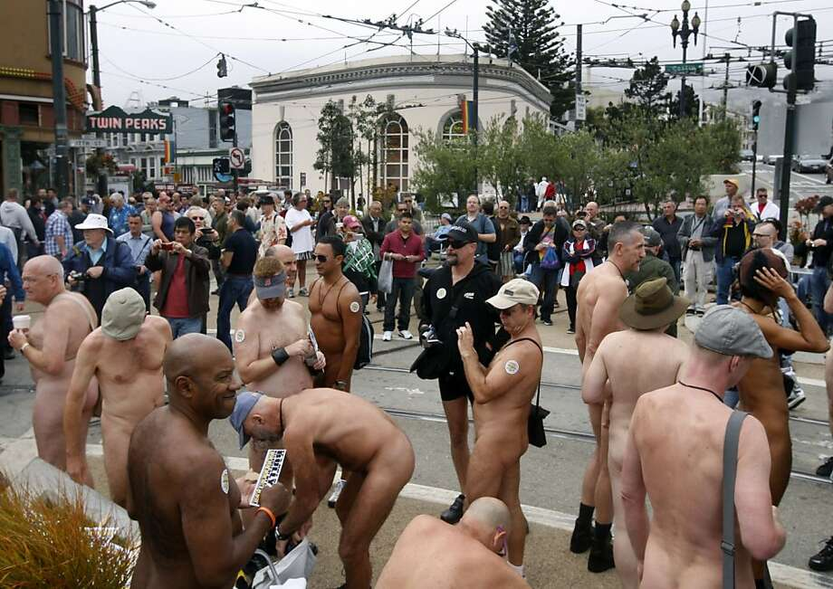Nudists gather for a nude-in at Castro and 17th streets in San Francisco, Calif. on Saturday, Sept. 24, 2011. Originally organized to celebrate the Folsom Street Fair, the event gained popularity after Supervisor Scott Wiener's proposal to force nudists to sit on handkerchiefs or towels in public. Photo: Paul Chinn, The Chronicle