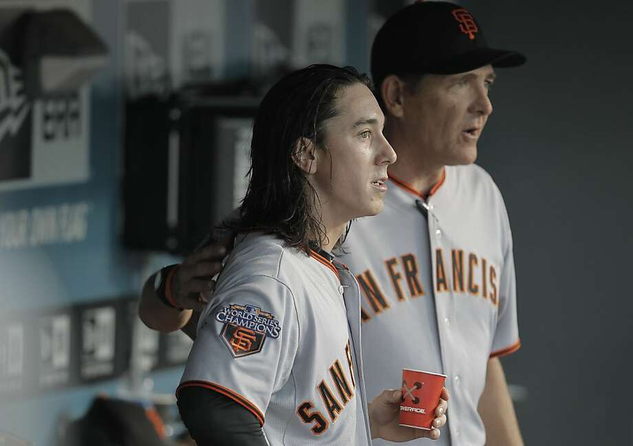 Pitching coach Dave Righetti talks with starting pitcher Tim Lincecum after the sixth inning after Los Angeles score one run, as the San Francisco Giants take on the Los Angeles Dodgers in the season opener on Thursday Mar. 31, 2011, at Dodger Stadium, in Los Angeles, Ca.   Ran on: 04-01-2011 Pitching coach Dave Righetti talks with Tim Lincecum after the sixth inning, in which Los Angeles scored an unearned run. Ran on: 04-01-2011 Pitching coach Dave Righetti talks with starting pitcher Tim Lincecum after the sixth inning, in which Los Angeles scored an unearned run  --  the only run Lincecum allowed. Photo: Michael Macor, The Chronicle