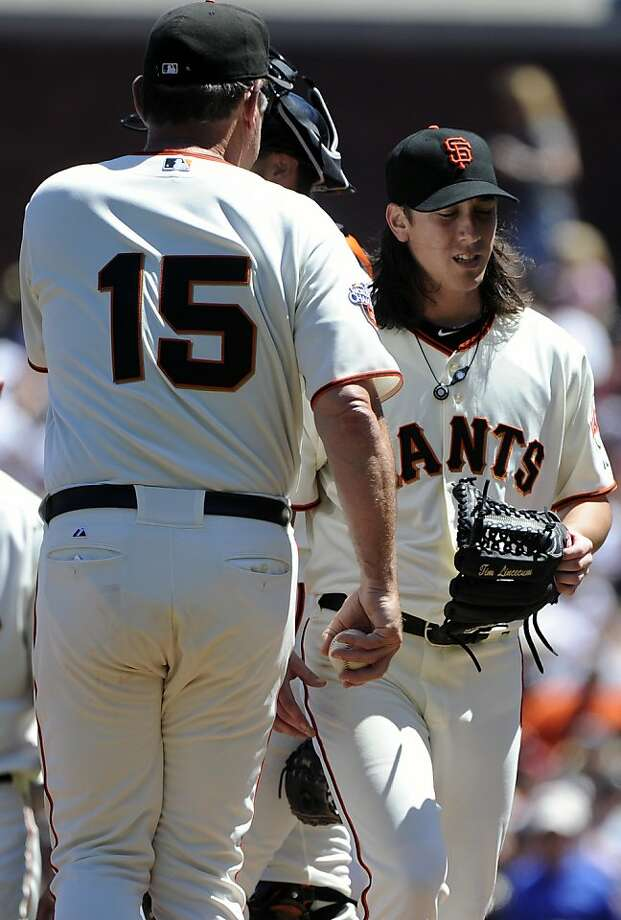 SAN FRANCISCO, CA - JULY 20: Manager Bruce Bochy #15 of the San Francisco Giants takes out pitcher Tim Lincecum #55 against the Los Angeles Dodgers in the seventh inning during an MLB baseball game at AT&T Park July 20, 2011 in San Francisco, California. The Dodgers won the game 1-0. (Photo by Thearon W. Henderson/Getty Images) Ran on: 07-21-2011 Giants manager Bruce Bochy removes starting pitcher Tim Lincecum after he gave up a leadoff walk in the eighth inning. Ran on: 07-21-2011 Giants manager Bruce Bochy removes starting pitcher Tim Lincecum after he gave up a leadoff walk in the eighth inning. Photo: Thearon W. Henderson, Getty Images