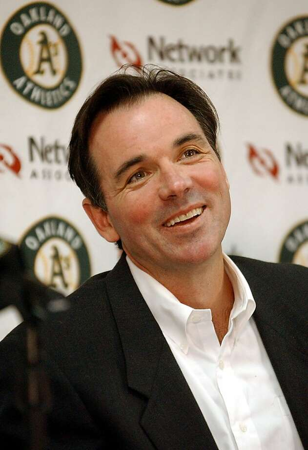 Oakland Athletics general manager Billy Beane smiles during a news conference in Oakland, Calif., Monday, Nov. 11, 2002. Beane decided to stay with the Athletics after withdrawing from consideration for the same job with the Boston Red Sox on Sunday night, ending a whirlwind weekend in which he was expected to leave. (AP Photo/Justin Sullivan) Also Ran on: 10-17-2006 Don't look for A's GM Billy Beane to change his mind about Ken Macha, as he did a year ago. Ran on: 10-17-2006 Don't look for A's general manager Billy Beane to change his mind about Macha, as he did a year ago. Photo: Justin Sullivan, AP
