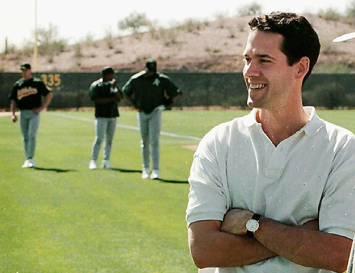 ** FILE **Paul DePodesta, assistant to Oakland Athletics' general manager Billy Beane, watches a workout at the A's training facility in Phoenix, Ariz., Feb. 27, 1999. DePodesta was named general manager of the Los Angeles Dodgers on Monday, Feb. 16, 2004. The hiring was the first move made by new owner Frank McCourt, who bought the team Friday from News Corp. for $430 million, and came just two days before pitchers and catchers are scheduled report to spring training in Vero Beach, Fla. (AP Photo/The Oakland Tribune, Nick Lammers, File) Paul DePodesta, who left the A's in the offseason, has a Hall of Fame ally to call upon in Dodgers vice president Tommy Lasorda. Paul DePodesta, who left the A's in the offseason, has a Hall of Fame ally to call upon in Dodgers vice president Tommy Lasorda. Ran on: 07-27-2008 Paul DePodesta, former assistant to A's general manager Billy Beane, works for the Padres now and blogs about the inner workings of the front office. Ran on: 10-18-2008 Brad Pitt, left, who made a rep as a sex symbol in such Hollywood fare as Thelma & Louise,'' will put on his thinking cap to play brainiac Billy Beane.