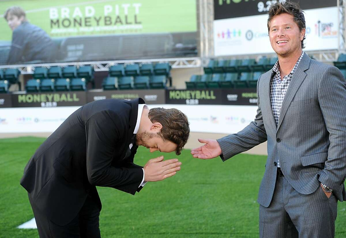 """Former Oakland A's player Scott Hatteberg, right, gets a bow from actor Chris Pratt, who plays him in """"Moneyball,"""" during the movie's premiere at the Paramount Theatre on Monday, Sept. 19, 2011, in Oakland, Calif."""