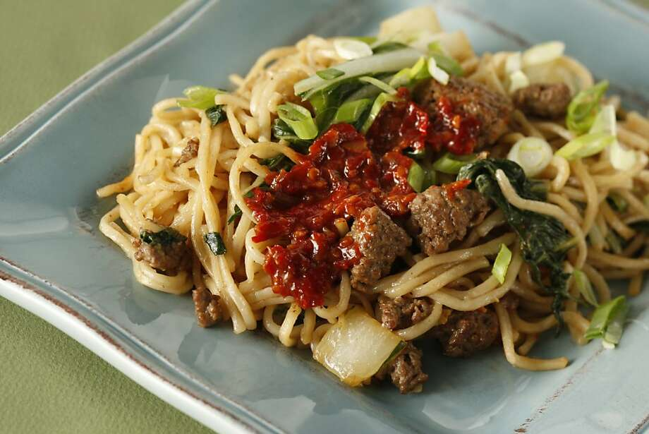 Seared Noodles with Turkey and Bok Choy in San Francisco, Calif., on December 18, 2008. Food styled by Caitlin Olmstead. Ran on: 01-07-2009 Stir fry marinated lamb with noodles and vegetables for a savory family-friendly entree  --  and don't forget to pass the chile-garlic sauce. Photo: Craig Lee, The Chronicle