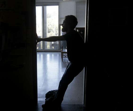 A protester stands in the doorway of an empty classroom after students, angered by continually rising tuition and cutbacks, take over the ground floor of Tolman Hall on the UC Berkeley campus on Thursday, Sept. 22, 2011. Photo: Paul Chinn, The Chronicle
