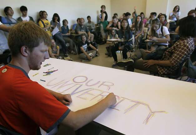 Freshman Adam Niemann scrawls a message on paper while students take over an empty classroom in Tolman Hall at UC Berkeley on Thursday, Sept. 22, 2011. About a hundred students, angered by rising tuition costs, took over the building for several hours. Photo: Paul Chinn, The Chronicle