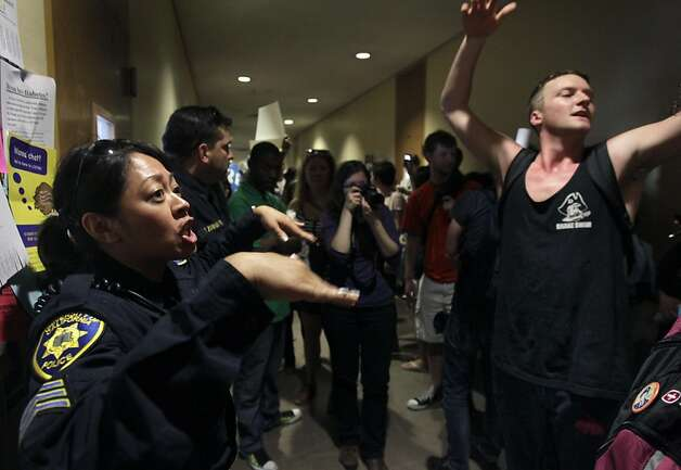 A UC police sergeant tries to calm angry protesters who attempt to occupy empty classrooms in Tolman Hall at UC Berkeley on Thursday, Sept. 22, 2011. Photo: Paul Chinn, The Chronicle