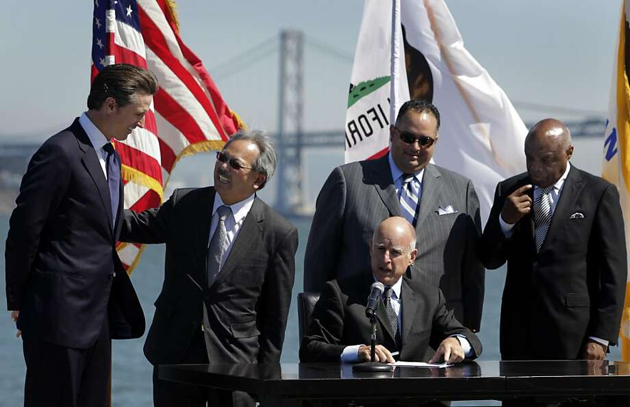Gov. Jerry Brown signs AB 664, which will help San Francisco finance the infrastructure and create 8,000 jobs for the America's Cup yacht race, in San Francisco, Calif. on Friday, Sept. 23, 2011. Joining the governor on stage for the ceremony were Lt. Gov. Gavin Newsom, Mayor Edwin Lee, House Speaker John Perez and former San Francisco Mayor Willie Brown. Photo: Paul Chinn, The Chronicle