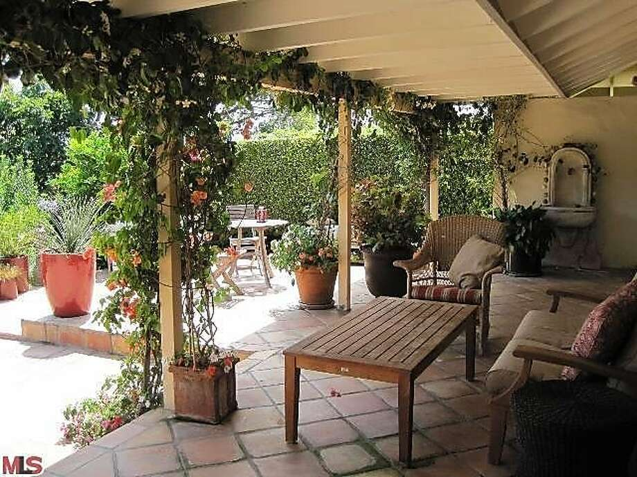 The foliage surrounding the architecture makes for an almost vineyard-like feel to the patio. Photo: Courtesy Of MLSFinder.com