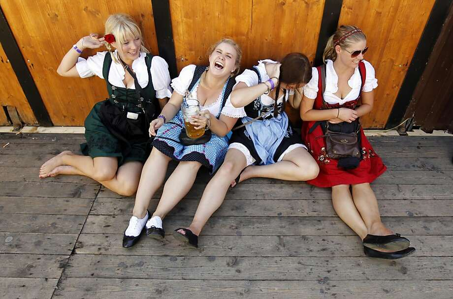 "Young visitors rest during the opening ceremony of the famous Bavarian ""Oktoberfest"" beer festival in Munich, southern Germany, on Saturday, Sept.17, 2011. More than six million guests from around the world are expected to descend on the beer tents of Munich to celebrate Oktoberfest over the next 17 days.  Last year's visitors consumed some 7.1 million 2-pint (1-liter) mugs of beer.  (AP Photo/Matthias Schrader) Photo: Matthias Schrader, AP"