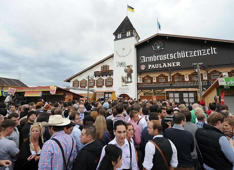 People wait to enter a beer festival tent before the start of the Oktoberfest beer festival at the Theresienwiese ground in Munich, southern Germany, on September 17, 2011. The 178th edition of the world's biggest beer festival which excepted to attract around six million visitors starts today and runs until October 3, 2011. AFP PHOTO/CHRISTOF STACHE (Photo credit should read CHRISTOF STACHE/AFP/Getty Images) Photo: Christof Stache, AFP/Getty Images