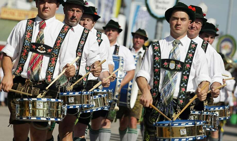 MUNICH, GERMANY - SEPTEMBER 17:  Traditionally Bavarian dressed members of a drummer group arrive for the opening day of the Oktoberfest 2011 beer festival at Theresienwiese on September 17, 2011 in Munich, Germany.  (Photo by Johannes Simon/Getty Images) Photo: Johannes Simon, Getty Images