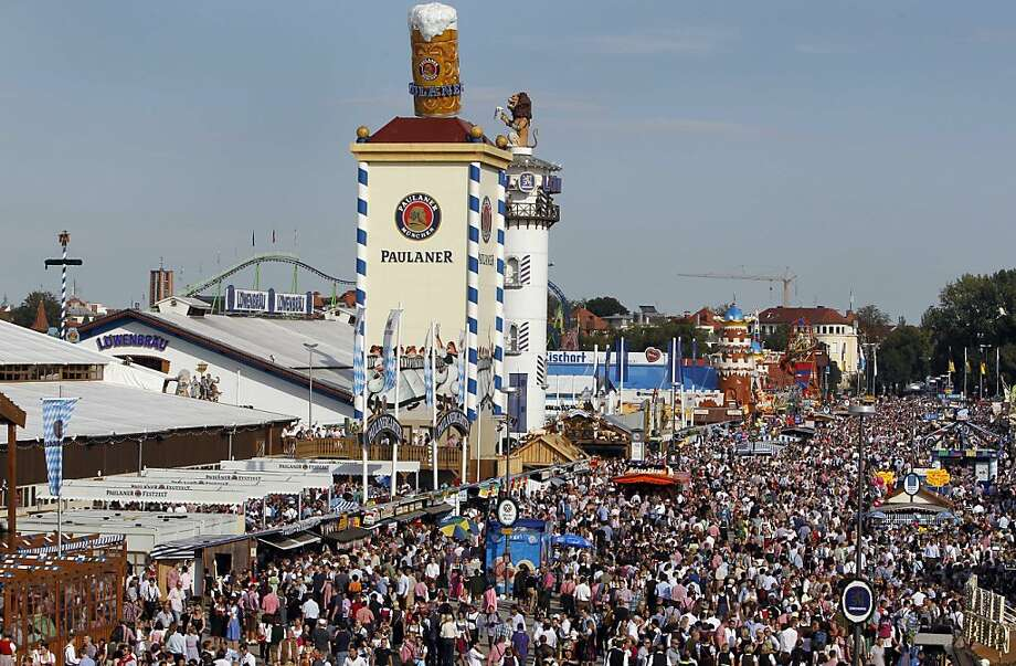 "Visitors attend the first day at the famous Bavarian ""Oktoberfest"" beer festival in Munich, southern Germany, on Saturday, Sept. 17, 2011. The world's largest beer festival, to be held from Sept. 17 to Oct. 3, 2011 will see some million visitors. (AP Photo/Matthias Schrader) Photo: Matthias Schrader, AP"