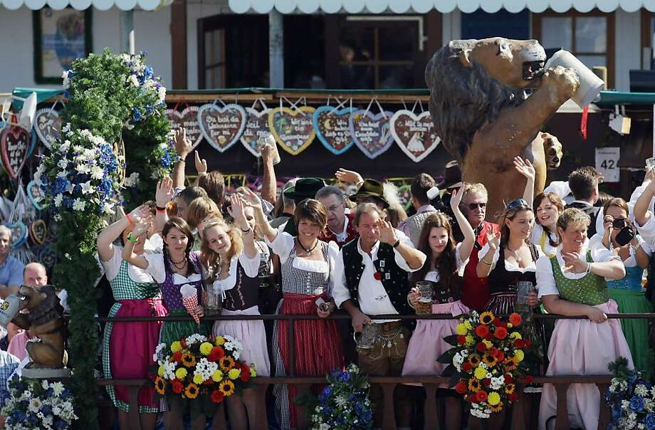 MUNICH, GERMANY - SEPTEMBER 17:  Waitresses on in a horse coach are wave during the big entry for the opening of the Oktoberfest 2011 beer festival at Theresienwiese on September 17, 2011 in Munich, Germany.  (Photo by Johannes Simon/Getty Images) Photo: Johannes Simon, Getty Images