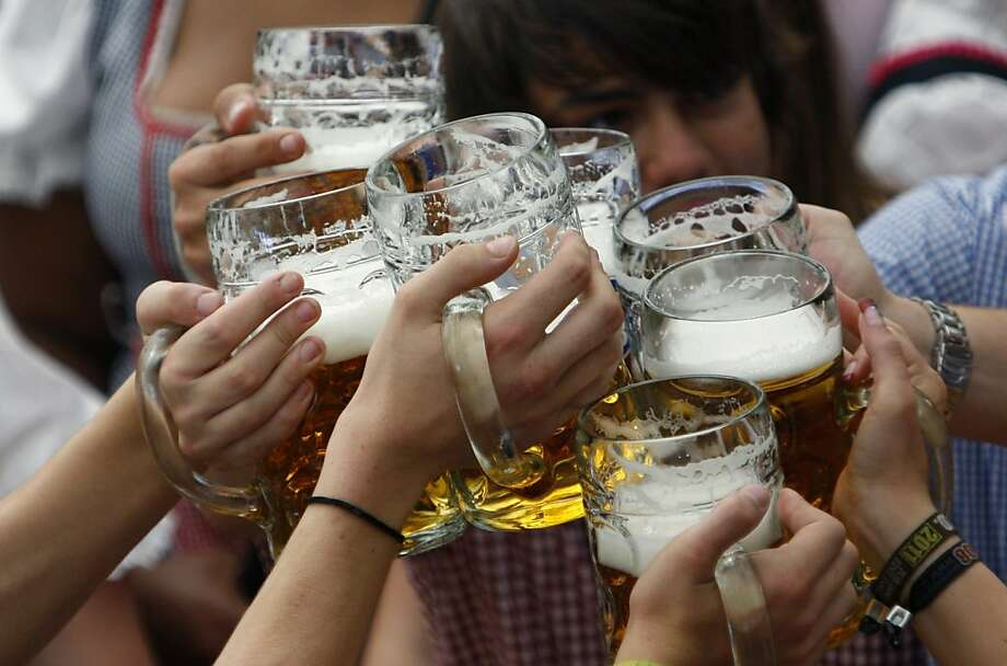 "Visitors lift their beer mugs in the Hofbraeuhaus-tent after the opening of the famous Bavarian ""Oktoberfest"" beer festival in a beer tent in Munich, southern Germany, on Saturday, Sept.17, 2011. The world's largest beer festival, to be held from Sept. 17 to Oct. 3, 2011 will see millions of visitors. (AP Photo/Matthias Schrader) Photo: Matthias Schrader, AP"
