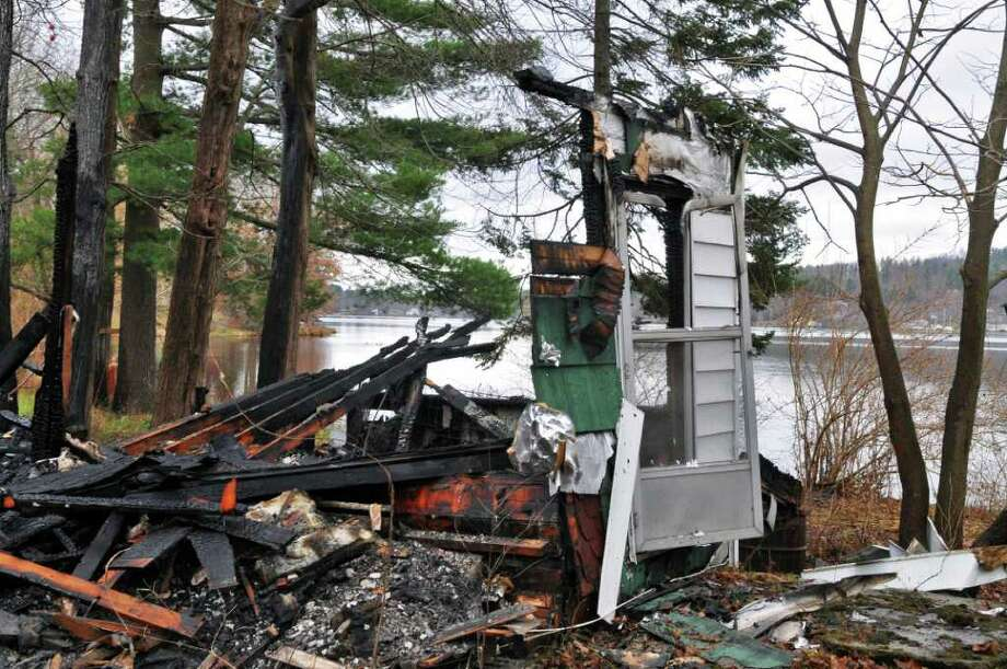 A vacant house on Morey Park Road on the shore of Nassau Lake in Schodack was destroyed by an overnight fire Tuesday Nov. 29, 2011.    (John Carl D'Annibale / Times Union) Photo: John Carl D'Annibale / 00015582A