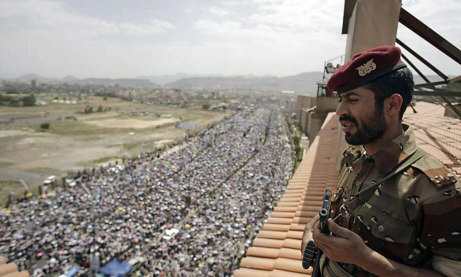 A Yemeni soldier looks on as he stands guard during a demonstration demanding the resignation of Yemeni President Ali Abdullah Saleh in Sanaa, Yemen, Friday, Sept. 16, 2011. (AP Photo/Hani Mohammed) Photo: Hani Mohammed, AP