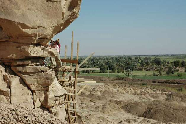 Wooden scaffolding constructed to reach the rock art at the Qurta site in Egypt, which overlooks the Nile Valley. Photo: Contributed Photo / Connecticut Post Contributed