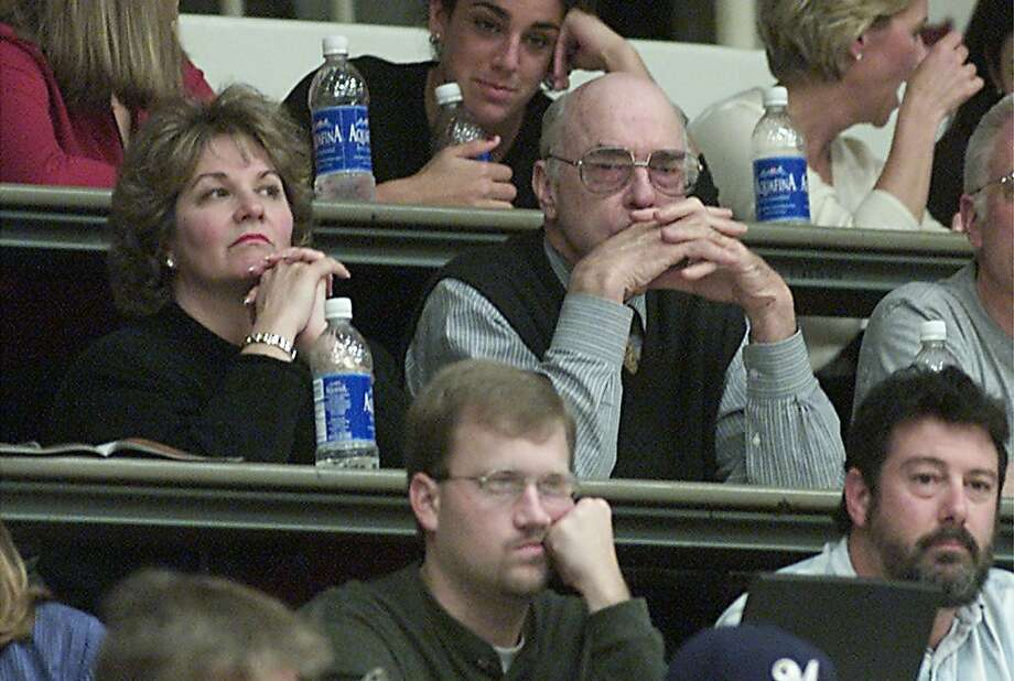 ARRILLAGA3-C-18DEC00-SP-JC--  Stanford booster John Arrillaga watches as Stanford plays Sacred Heart at Maples Pavillion with Ted Leland's wife Stephanie on Monday evening in Palo Alto. Photo by Jeff Chiu / The Chronicle. Photo: Jeff Chiu, The Chronicle