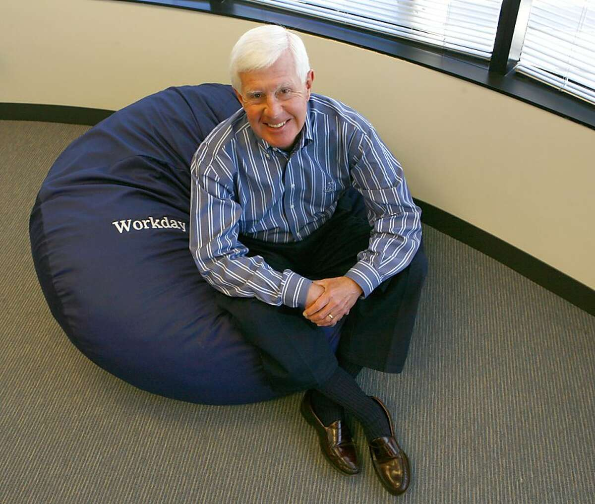 Dave Duffield poses in one of the bean bag chairs set up in the company's game room.After fighting the hostile takeover of his company, PeopleSoft, Dave Duffield founded a new startup in Walnut Creek with 107 employees called Workday. And that startup is taking bold aim at his old nemesis, Oracle's Larry Ellison, by selling software that lets companies manage business tasks via the Internet instead of installing costly programs on company computers. Photo by Michael Maloney / San Francisco Chronicle Photo taken on 6/8/07 in Walnut Creek, CA *** Ran on: 06-17-2007 David Duffield relaxes in a beanbag chair in the game room at Workday, where the congenial atmosphere is a reminder of his days at PeopleSoft. Ran on: 06-17-2007 David Duffield relaxes in a beanbag chair in the game room at Workday, where the congenial atmosphere is a reminder of his days at PeopleSoft. Ran on: 12-04-2008 Entrepreneur David Duffield serves as Workday Inc. CEO and chief consumer advocate.