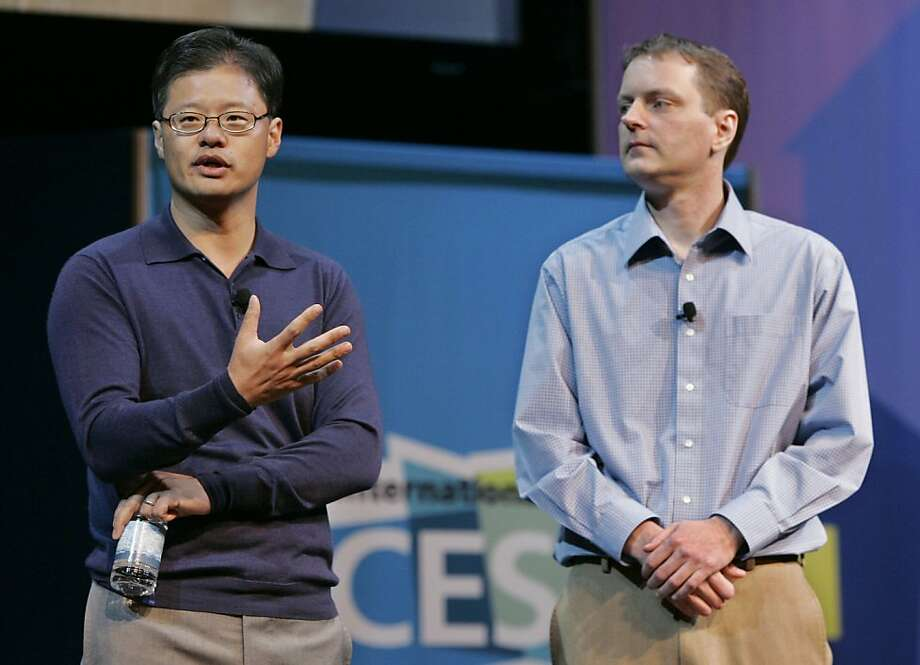 "** FILE ** In this Jan. 7, 2008 file photo, Yahoo CEO Jerry Yang, left, gives a keynote address as Yahoo co-founder David Filo, right, listens at the Consumer Electronics Show (CES) in Las Vegas. Yahoo said Monday Nov. 17, 2008 that Yang will step down as the Internet company's CEO as soon as a successor is found. Yang, who started Yahoo with Stanford University classmate David Filo in 1994, will revert to ""Chief Yahoo,"" a titular role he filled before replacing former movie studio boss Terry Semel as CEO in June 2007.(AP Photo/Paul Sakuma, file) Ran on: 11-18-2008 Jerry Yang said he will resign after a successor is found. He will remain on the board. Photo: Paul Sakuma, AP"