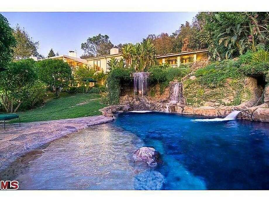 The gorgeous waterfall, pool and grotto of the property must be seen to believed. Photo: Courtesy Of Realtor.com