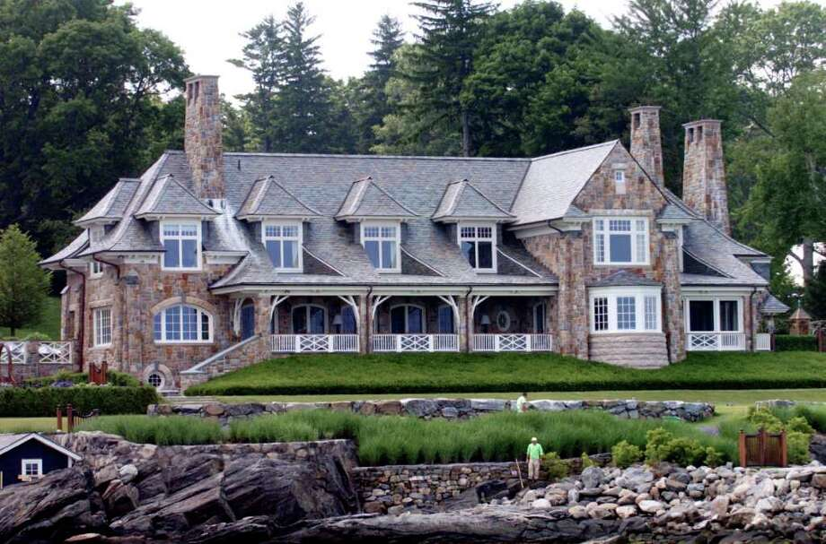 A Greenwich mansion as seen from a boat on Greenwich harbor appears in this file photo. Photo: Bob Luckey, ST / Greenwich Time