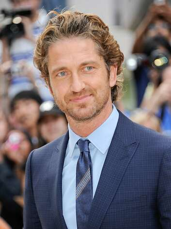 "Actor Gerard Butler attends a gala screening for the film ""Machine Gun Preacher"" during the Toronto International Film Festival on Sunday, Sept. 11, 2011 in Toronto. (AP Photo/Evan Agostini) Photo: Evan Agostini, AP"