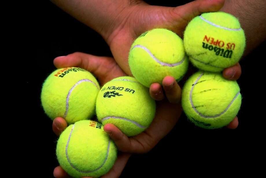 NEW YORK, NY - SEPTEMBER 11:  A ball person holds tennis balls during Day Fourteen of the 2011 US Open at the USTA Billie Jean King National Tennis Center on September 11, 2011 in the Flushing neighborhood of the Queens borough of New York City.  (Photo by Clive Brunskill/Getty Images) Photo: Clive Brunskill, Getty Images