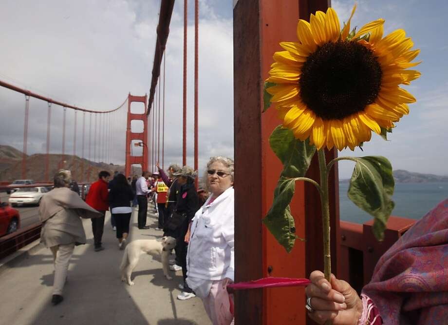 Ingrid Kepler-May holds a sunflower during a rally by hundreds of peace activists on the Golden Gate Bridge in San Francisco, Calif. on Sunday, Sept. 11, 2011. Photo: Paul Chinn, The Chronicle