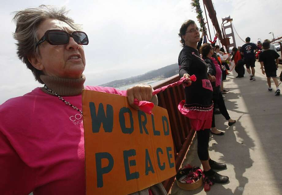 Ellie Hawkins (left) joins hundreds of other activists on a march and peace rally on the Golden Gate Bridge in San Francisco, Calif. on Sunday, Sept. 11, 2011. Photo: Paul Chinn, The Chronicle