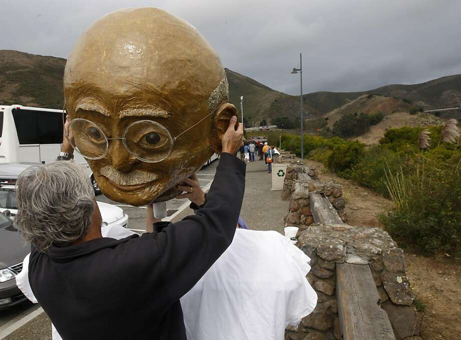 "Jes Reichardson assembles a likeness of Mahatma Gandhi before hundreds of peace activists march across the Golden Gate Bridge in San Francisco, Calif. on Sunday, Sept. 11, 2011, as part of a national campaign called ""Create, Not Hate"". The march was held to commemorate the tenth anniversary of the 9/11 attack and to call for an end to the war in Iraq and Afghanistan. Photo: Paul Chinn, The Chronicle"