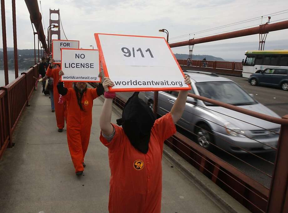 "Protesters dressed as Guantanamo war prisoners were among the hundreds of peace activists that marched across the Golden Gate Bridge in San Francisco, Calif. on Sunday, Sept. 11, 2011, as part of a national campaign called ""Create, Not Hate"". The march was held to commemorate the tenth anniversary of the 9/11 attack and to call for an end to the war in Iraq and Afghanistan. Photo: Paul Chinn, The Chronicle"