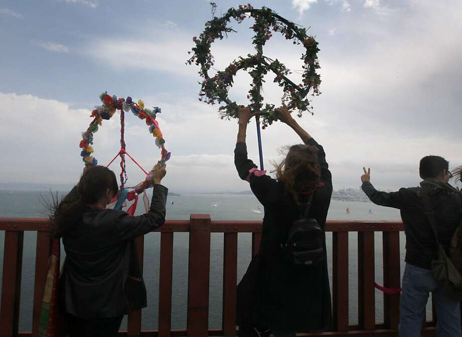 "Activists hold a peace rally on the Golden Gate Bridge in San Francisco, Calif. on Sunday, Sept. 11, 2011, as part of a national campaign called ""Create, Not Hate"". The march and rally was called to commemorate the tenth anniversary of the 9/11 attack and to call for an end to the war in Iraq and Afghanistan. Photo: Paul Chinn, The Chronicle"