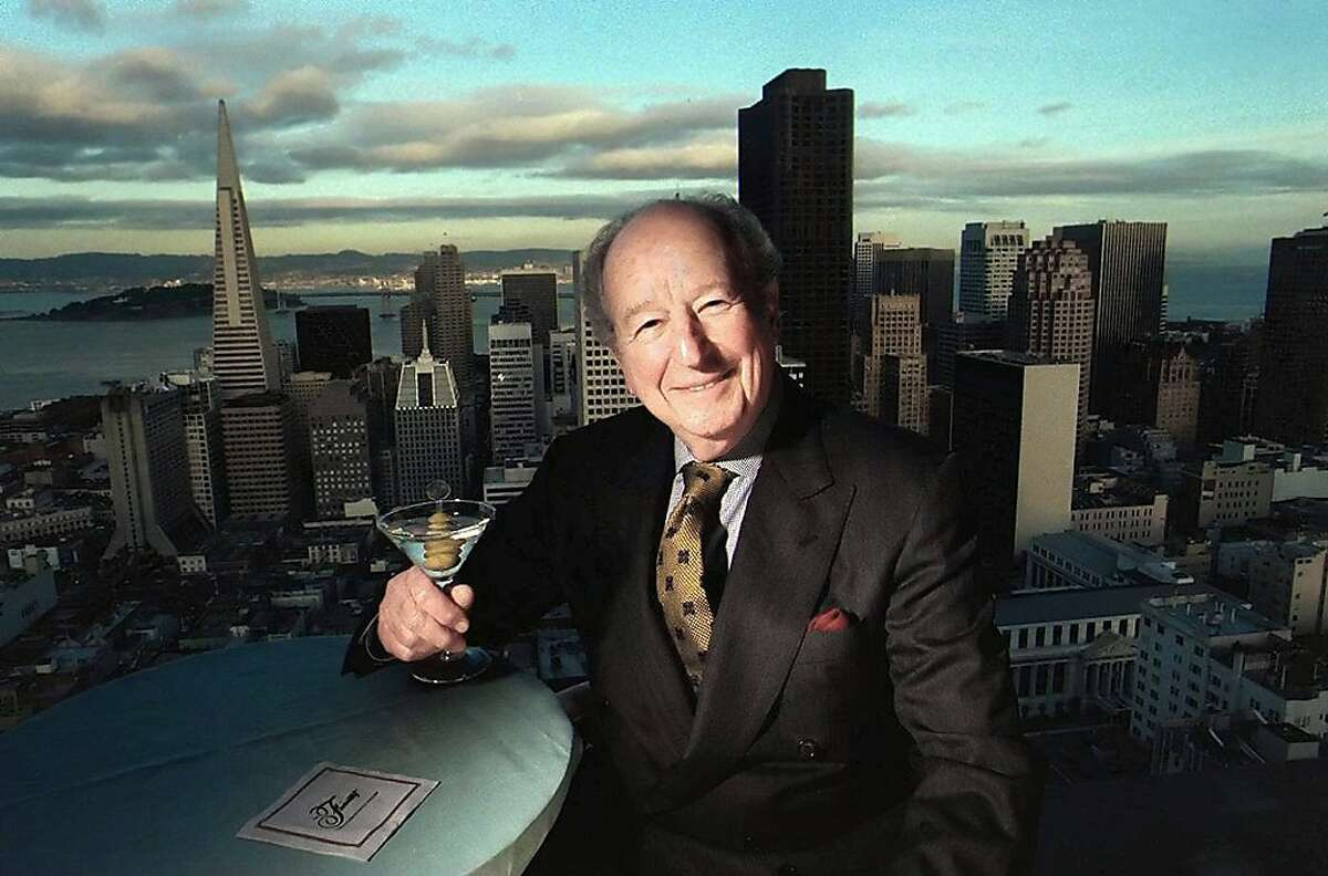 FILE--Pulitzer Prize-winning San Francisco Chronicle columnist Herb Caen, who chronicled his adopted city for nearly six decades to become its most recognized symbol of the good old days, is shown against the San Francisco skyline in this undated file photo. Caen died Saturday morning, Feb. 1, 1997, of lung cancer at the Pacific Medical Center in San Francisco. (AP Photo/San Francisco Chronicle, File)