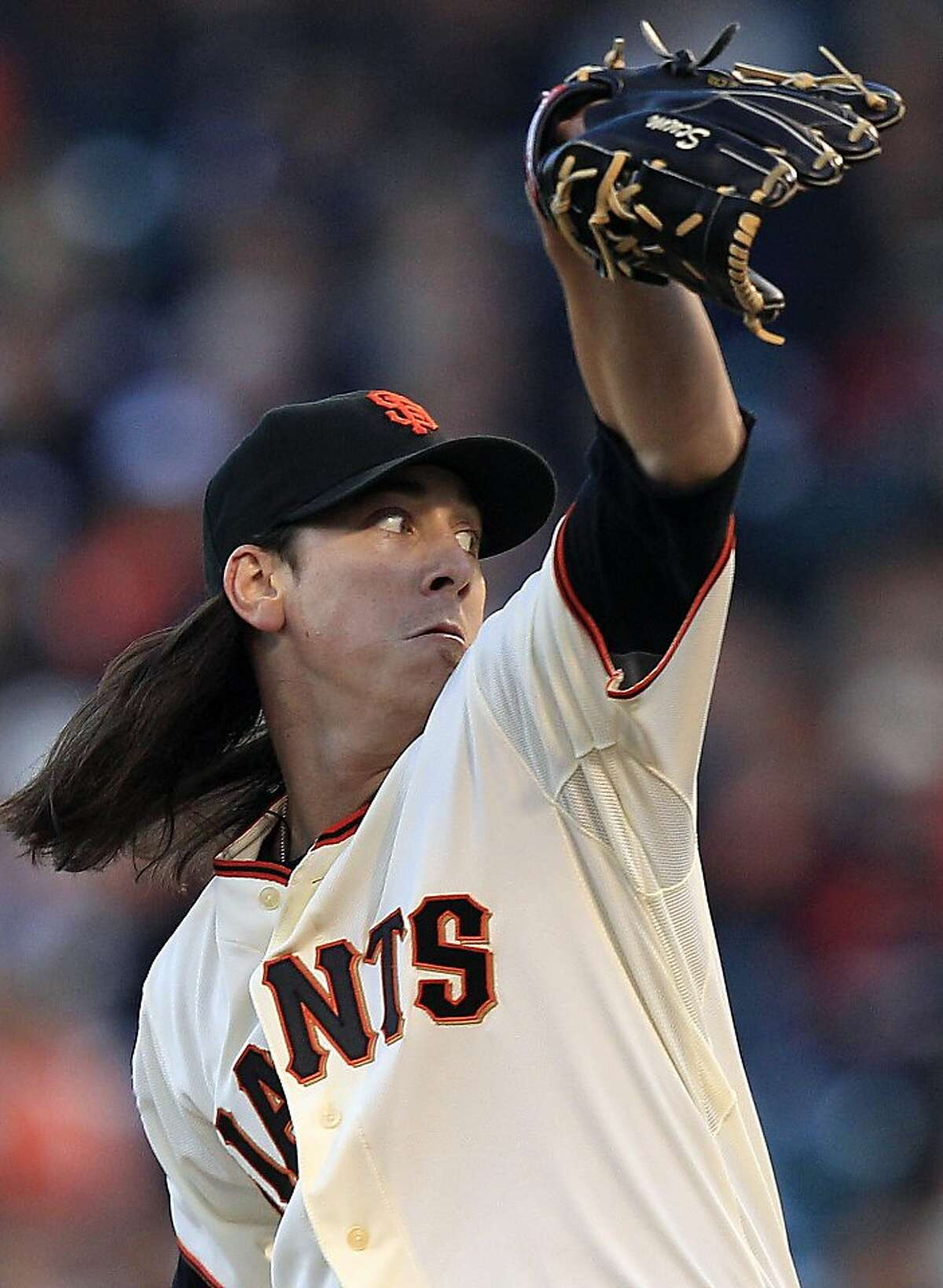 San Francisco Giants starting pitcher Tim Lincecum throws to the Chicago Cubs during the first inning of a baseball game in San Francisco, Monday, Aug. 29, 2011. (AP Photo/Marcio Jose Sanchez)