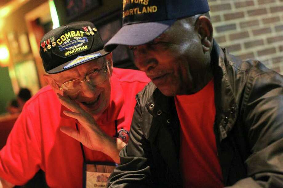 Donald Martin (left) and Johnny Singleton joke as a group of Alamo Honor Flight WW II veterans meet to share memories. Photo: FOR THE EXPRESS-NEWS, JENNIFER WHITNEY / Jennifer Whitney/special to the