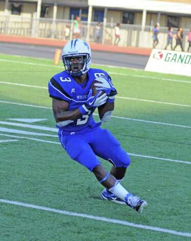 L. SCOTT HAINLINE: FOR THE CHRONICLE IN FORM: Dekaney senior running back Trey Williams and the Wildcats have a familiar foe on the schedule, and a little bit of revenge on their minds, facing Westfield Saturday in the Class 5A Division II state quarterfinals. Photo: L. Scott Hainline / freelance